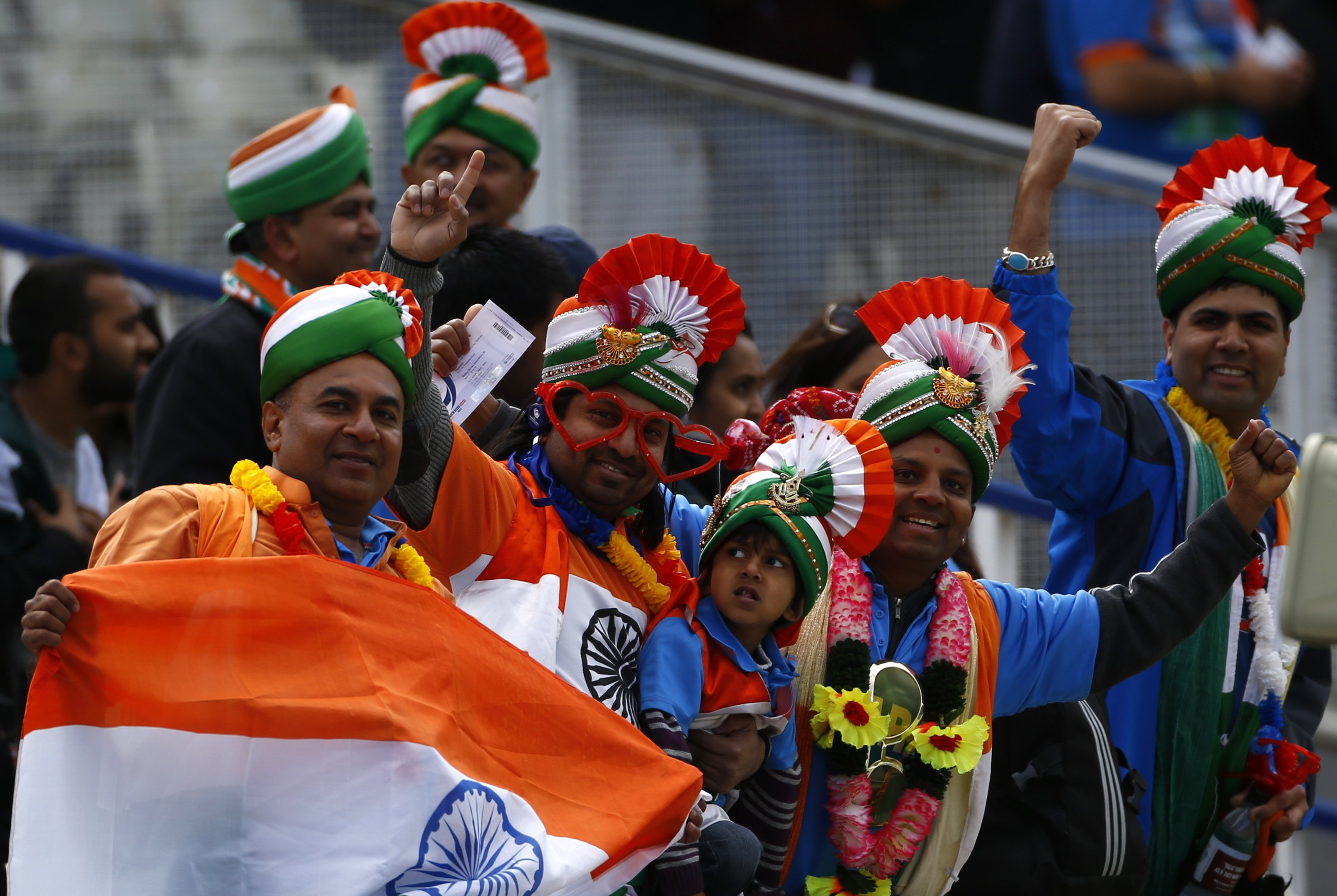 India fans pose before their ICC Champions Trophy group B match against Pakistan at Edgbaston cricket ground in Birmingham, central England, June 15, 2013. REUTERS/Darren Staples (BRITAIN - Tags: SPORT CRICKET)